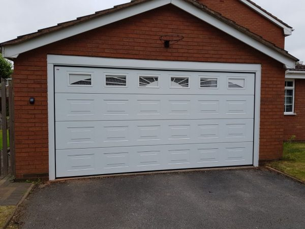 white insulated sectional garage door