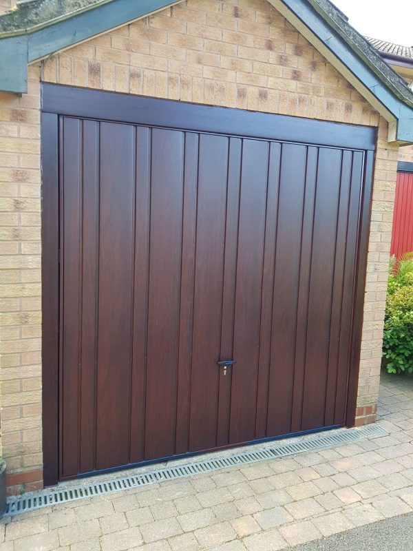 Dark wood canopy garage door
