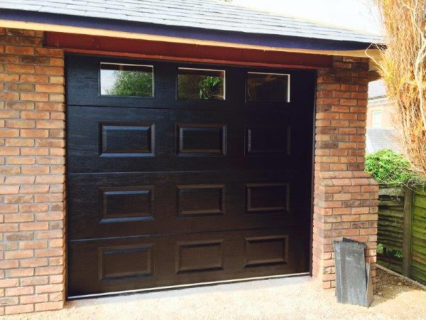 black sectional garage door with square windows