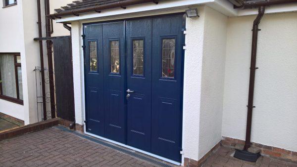 UPVC blue teckentrup side hinged garage door installation