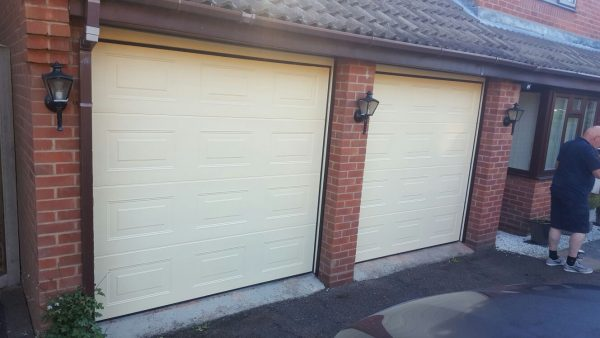 two ivory cardale sectional garage doors