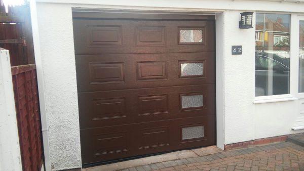 upvc brown sectional garage door installation