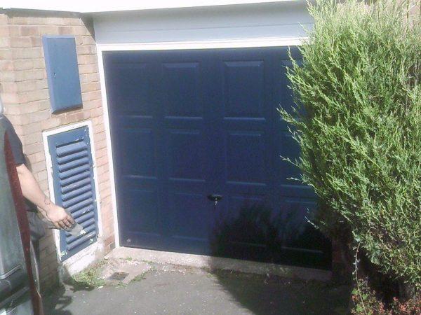 dark blue up and over garage door