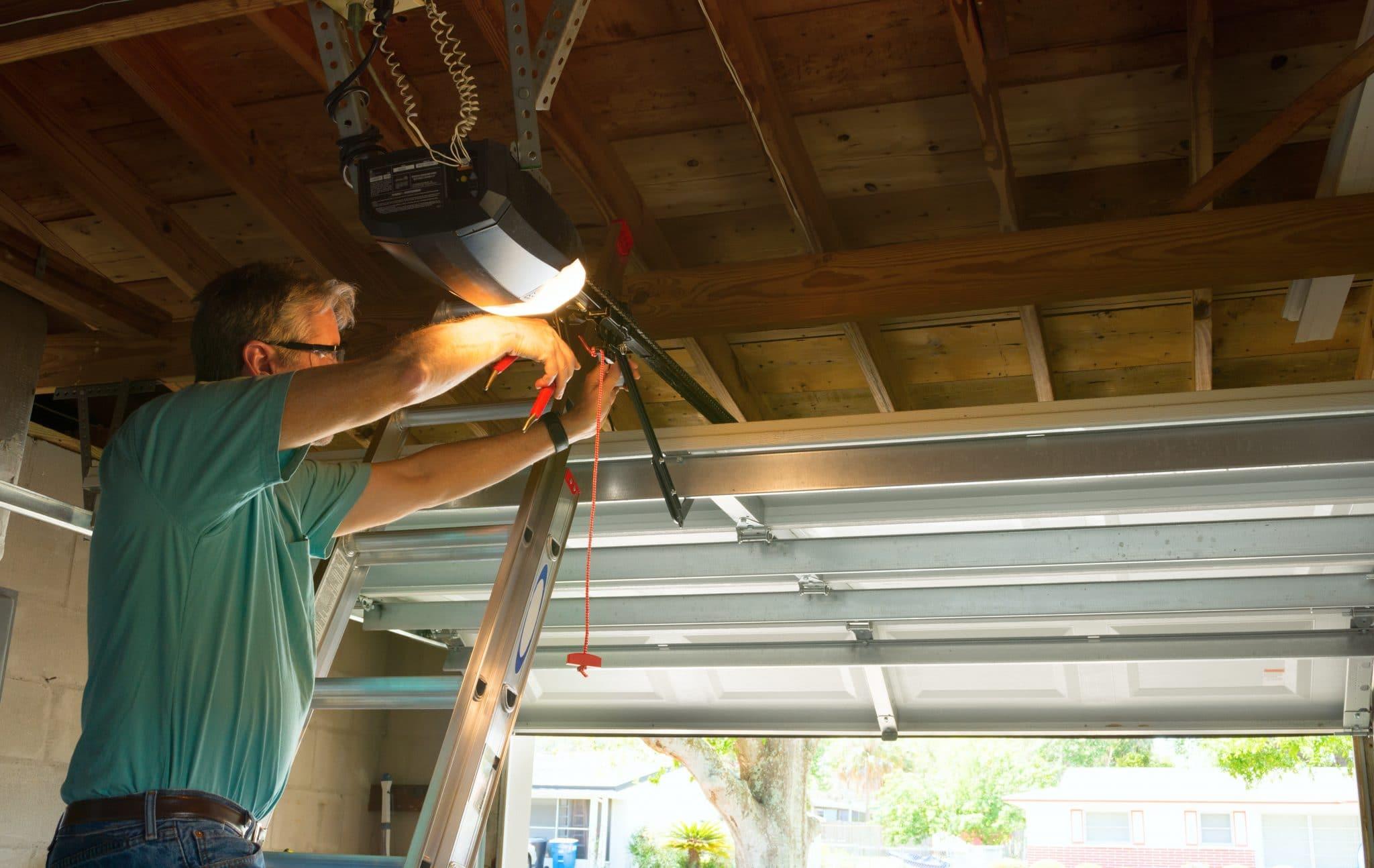 garage door repair man fixing a garage door opener